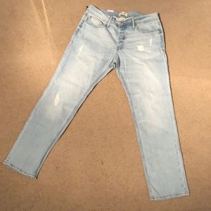 Other - Slim fit, light blue jeans with rips in front side
